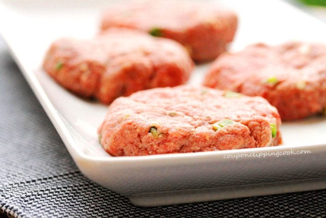 Raw ground beef patties on plate