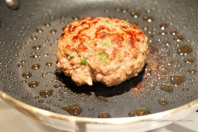 Cook ground beef patty in pan