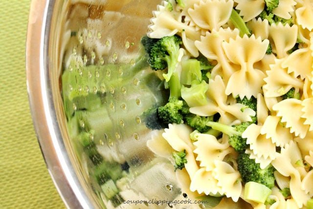 Broccoli and bow tie pasta in strainer