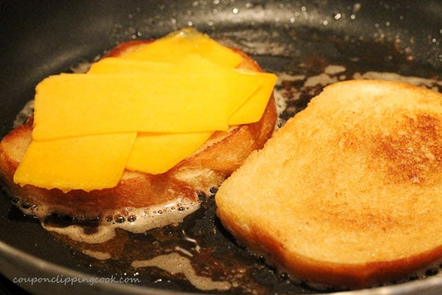 Sliced cheese on bread in pan