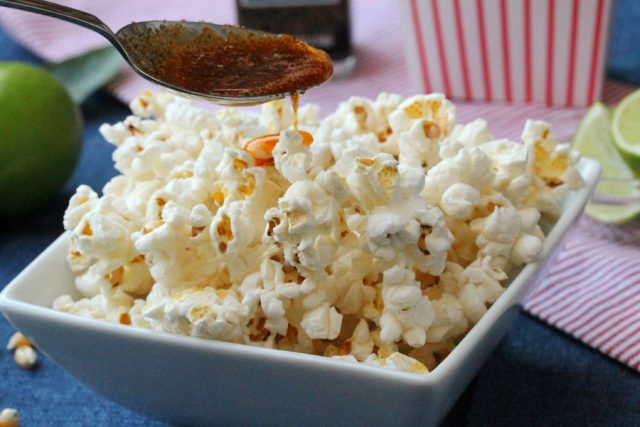 Add Spicy Butter on Popcorn in bowl