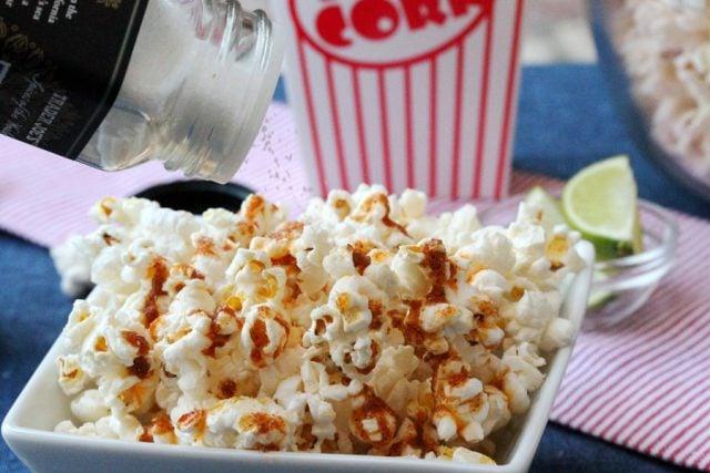 Add Salt on Popcorn in bowl