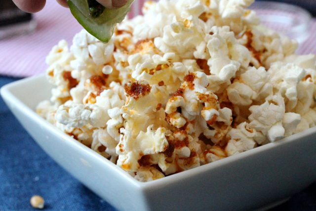 Add Lime Juice on Popcorn in bowl