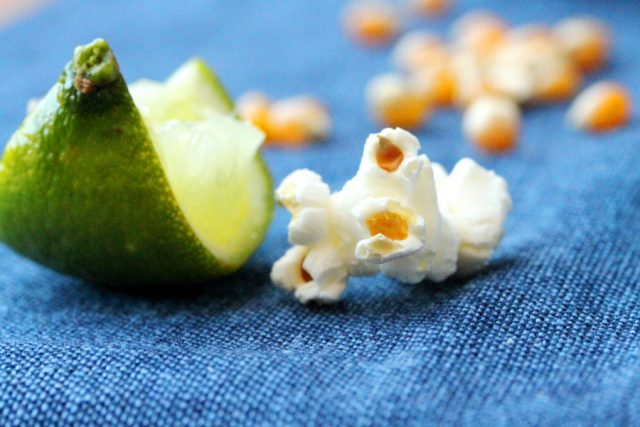 Quartered lime with piece of popcorn