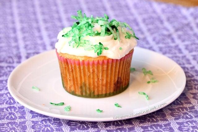 Add green coconut on cupcake
