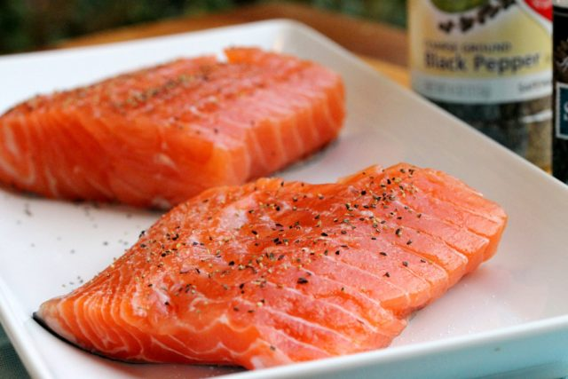 Pepper on Salmon Fillets on plate