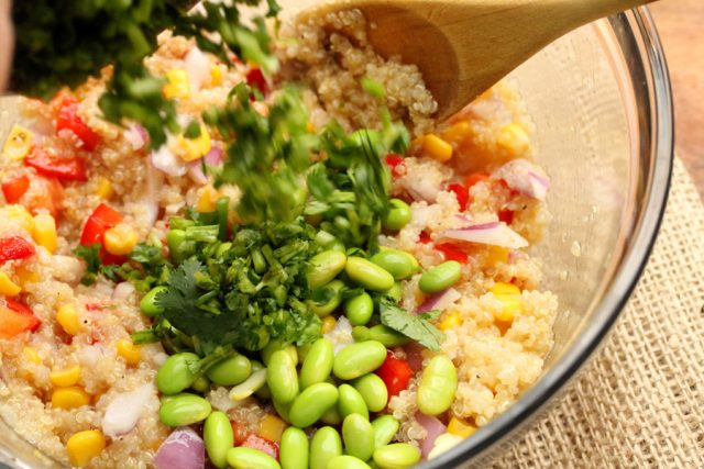 Add Cilantro to Quinoa Salad in bowl