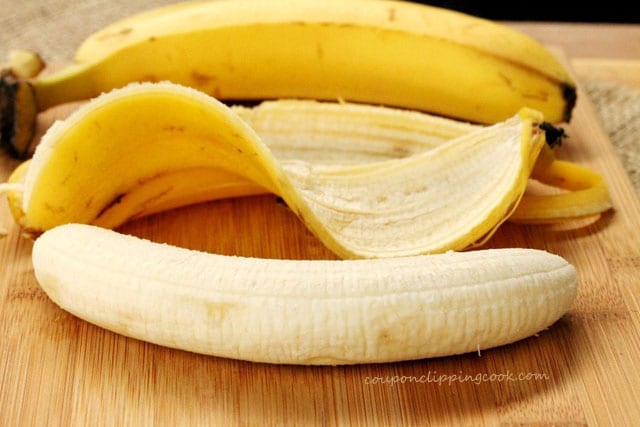 Peeled banana on cutting board