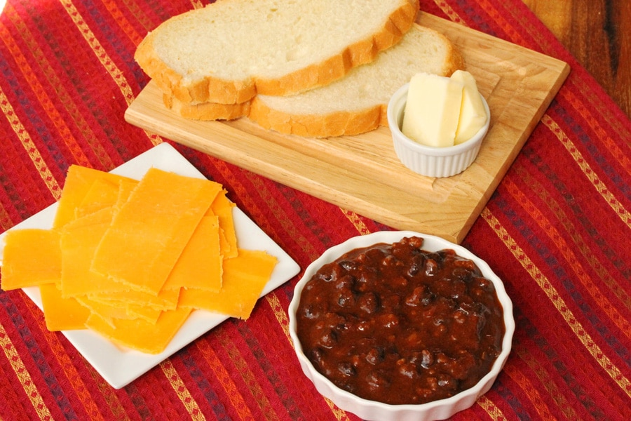 Sharp Cheddar Cheese, Sheepherder Bread, Butter, and Chili.