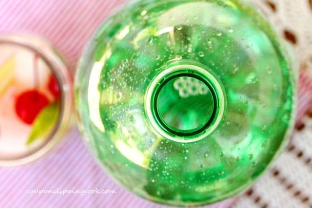 Looking in a bottle of lime soda pop