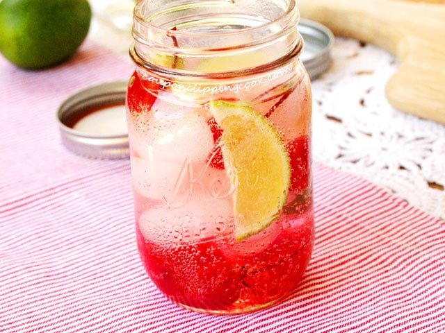 Lime soda, lime and cherries in jar