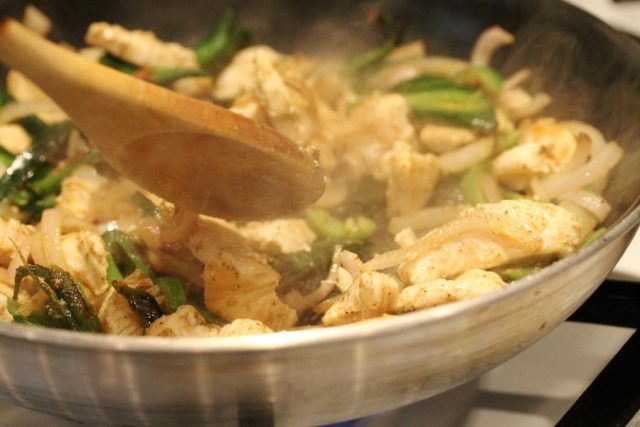 Cook chicken and peppers in pan