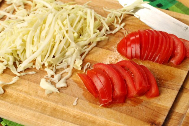 Sliced Cabbage and Tomato on board