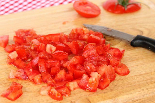 Cut Tomatoes on cutting board