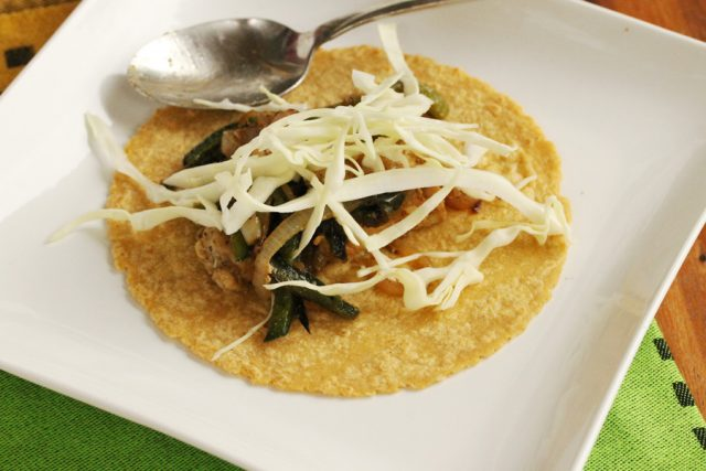 Cabbage on tortilla on plate