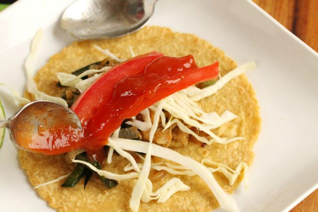 Add salsa to taco on plate