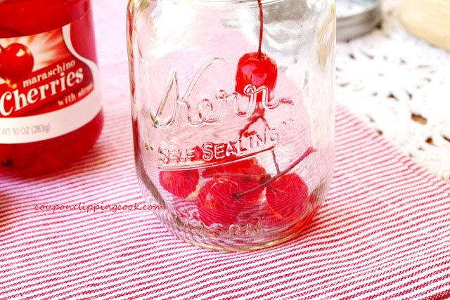 Cherries with stems in bottom of jar