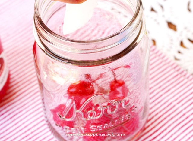 Add ice to jar with cherries