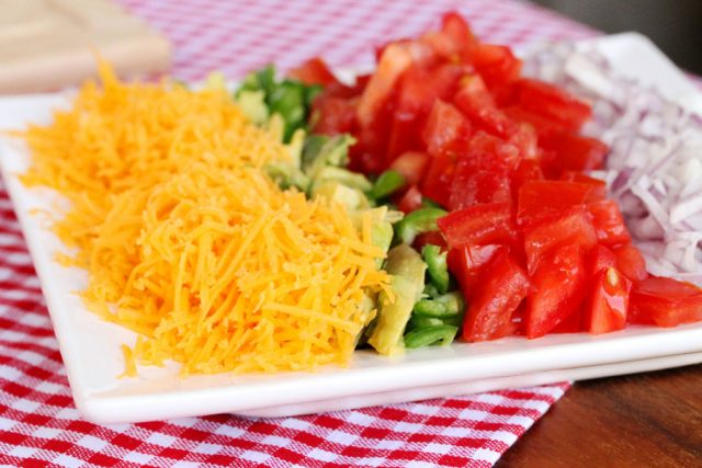 Shredded Cheese Tomatoes on plate
