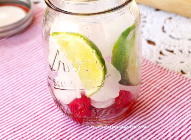 Lime cherries and ice in mason jar