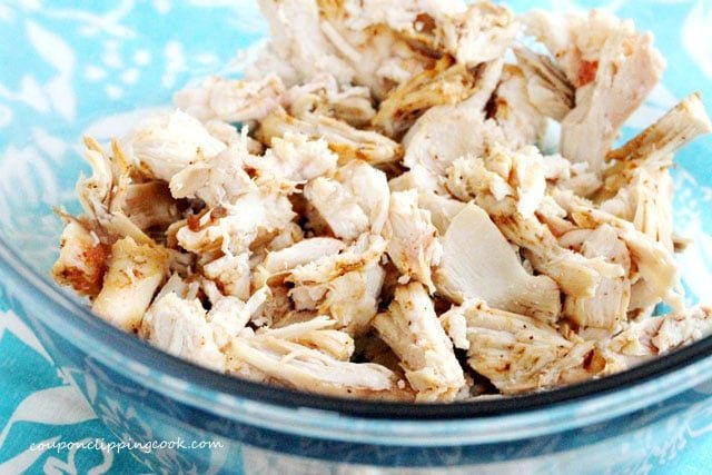 Shredded cooked chicken in bowl