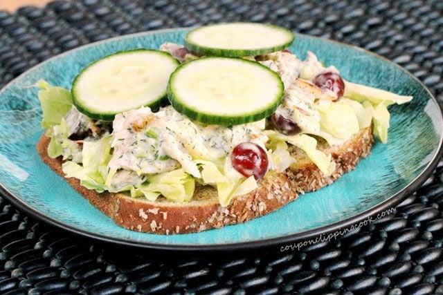Sliced cucumbers on chicken salad sandwich