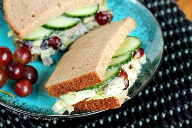 Chicken salad sandwich with red grapes and cucumber