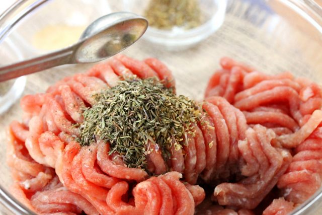 Dried Herbs in Ground Pork in bowl