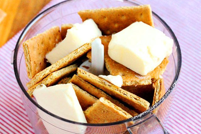 Butter and Graham Crackers in Mixer
