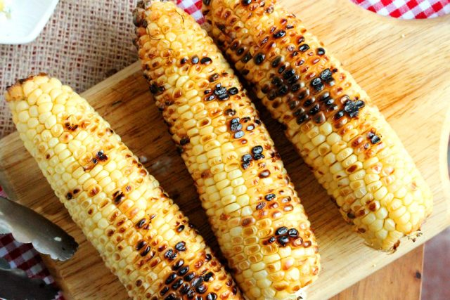 Grilled Corn on cutting board