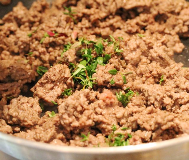 Thyme Leaves in Ground Beef in pan