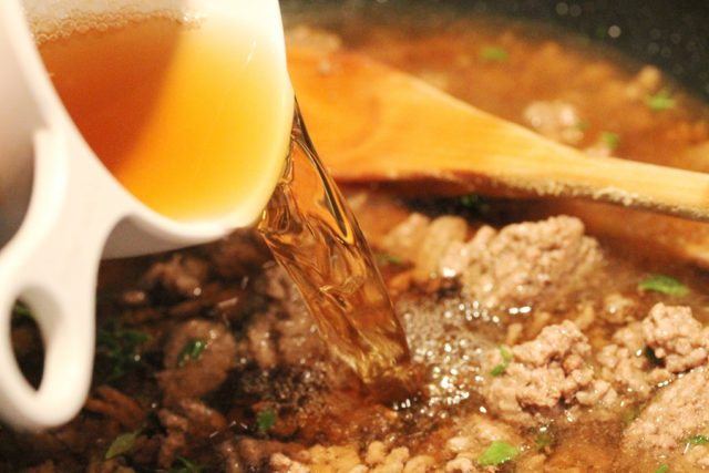 Add Beef Broth in skillet