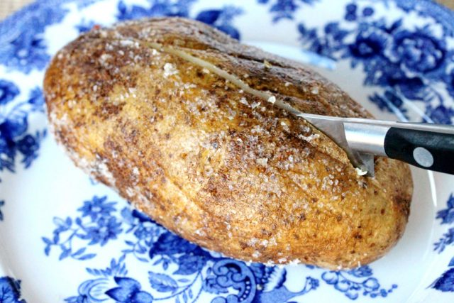 Baked Salt Crusted Potato on plate