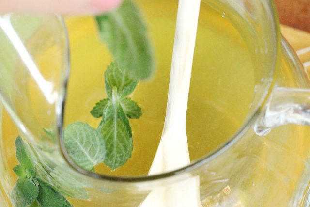 Stir Mint Limeade in pitcher