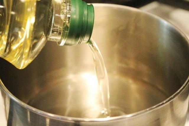 Pour Canola Oil in Pot
