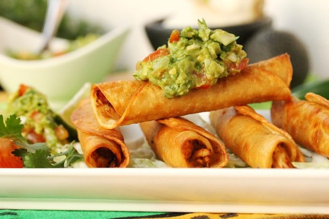 Chicken Taquitos with Guacamole on plate