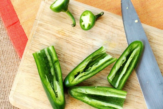 Cut jalapenos on cutting board