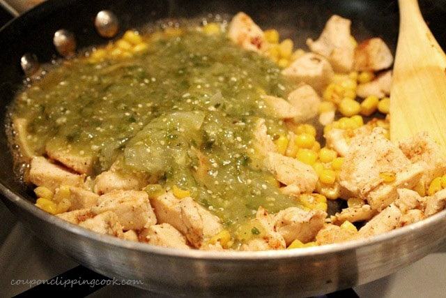 Salsa, corn and chicken in skillet
