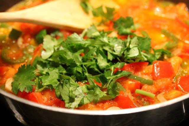 Add Cilantro to Tomatoes in pan