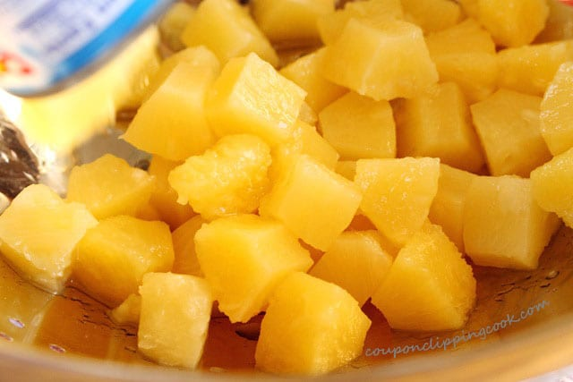 Cut pieces of pineapple in colander