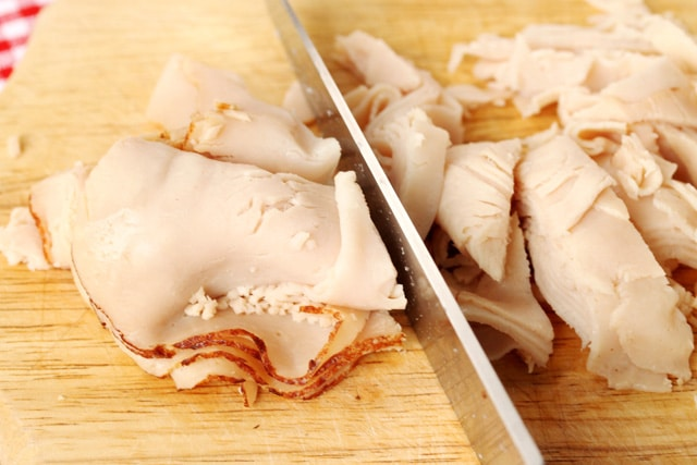 Cut Sliced Turkey on board
