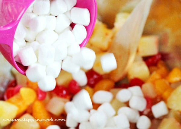 Add marshmallows to bowl with fruit cocktail