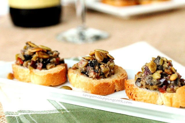 Olive tapenade on garlic toast on plate