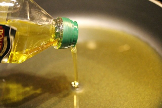 Pour Olive Oil in Pan