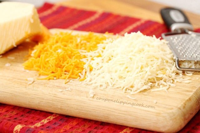 Shredded cheese on cutting board