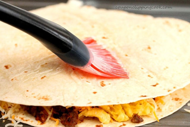 Brush butter on quesadillas