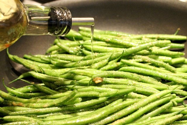 Add olive oil on green beans