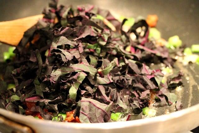 Kale onion butter in skillet