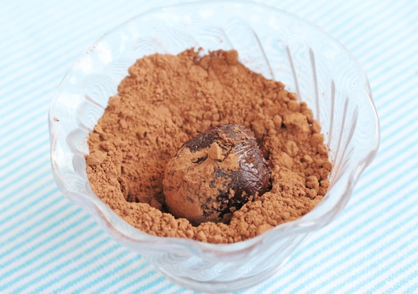 Chocolate truffle in cocoa powder in bowl