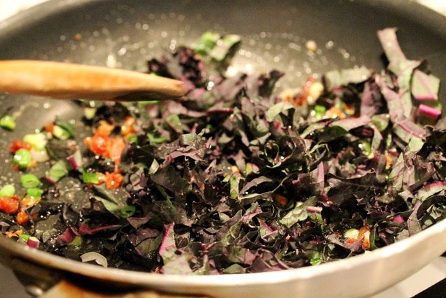 Stir kale onion butter and bacon in pan